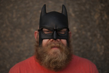 man with a beard in a batman mask