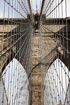 Web of wire cables suspending a bridge