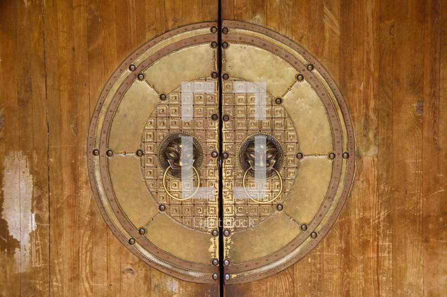 Golden door pulls on a Mongolian Palace door