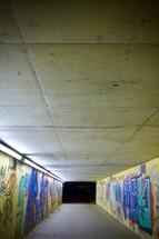 graffiti covered tunnel at night