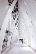 people walking in an airport terminal