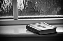 bible resting in a window sill