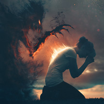 A woman prays to fight off the spirit of darkness