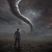 man watching a tornado