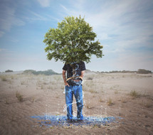 man holding a tree of knowledge growing from a Bible