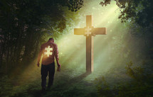 man with a missing puzzle piece standing in front of a cross