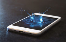water droplet splash on a cellphone screen