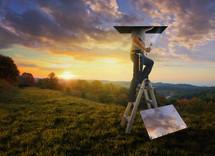 a man climbing a ladder into the sky