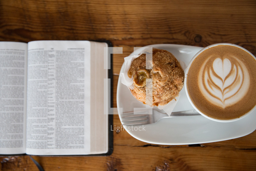open Bible, cappuccino, plate, muffin, breakfast
