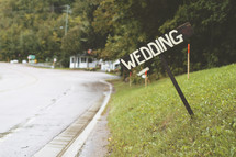 Wedding sign on a hill.