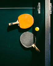 paddles on a ping pong table