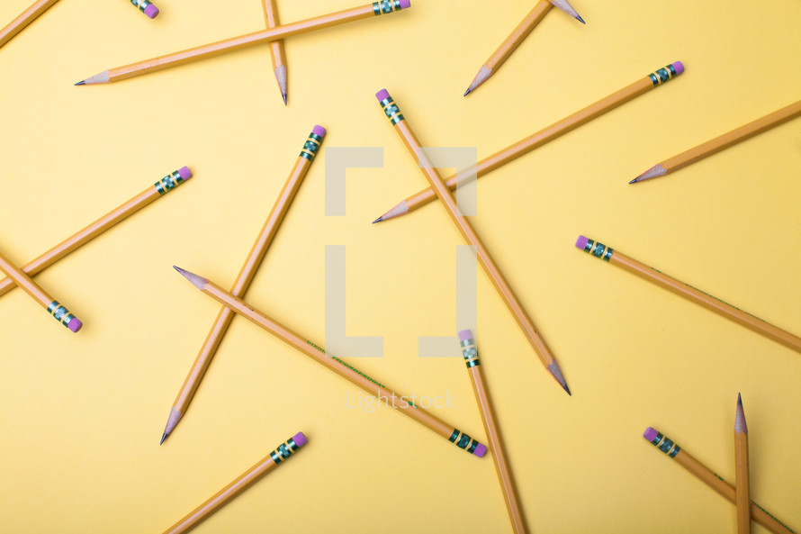sharpened pencils on a yellow background