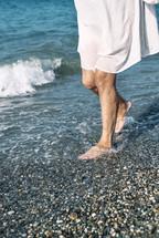 woman walking on a shore