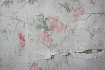 floral pattern on a pealing plaster wall
