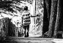 a boy walking away