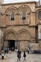 people entering the Church of the Holy Sepulchre in Jerusalem