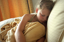 a young child sick in bed