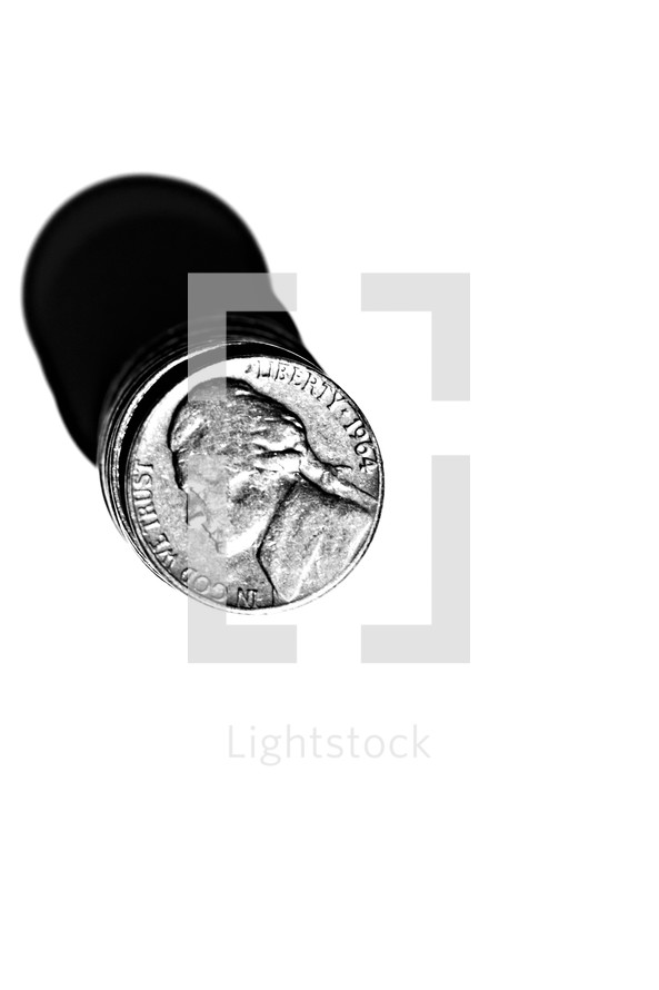 Stack of nickels isolated in white