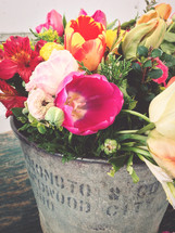 A bucket of  spring flowers.