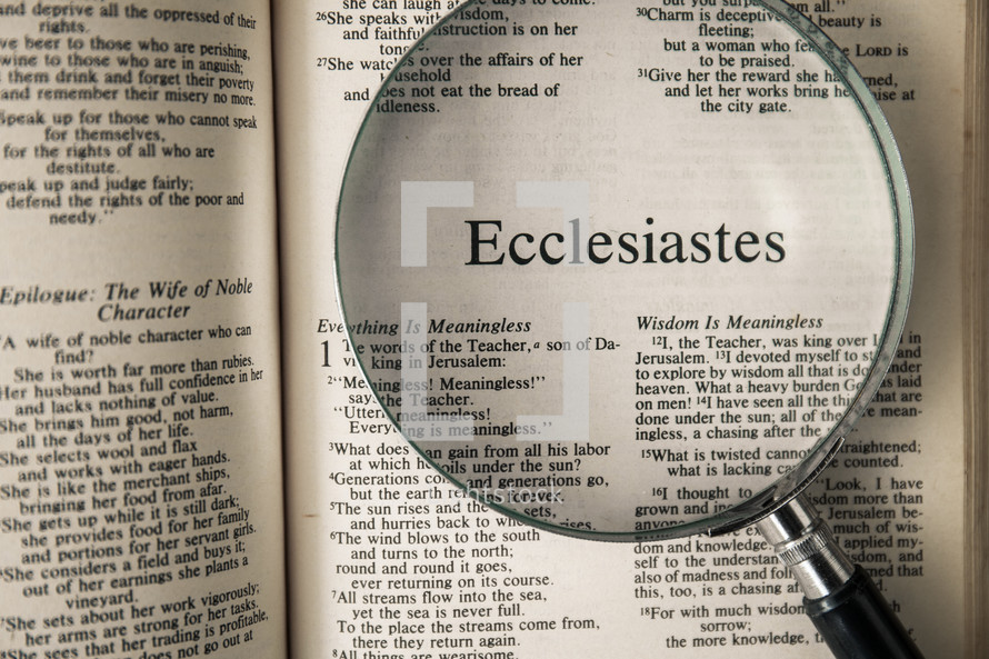 magnifying glass over Bible - Ecclesiastes
