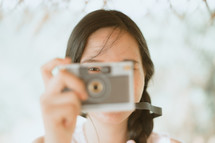 a woman holding a camera