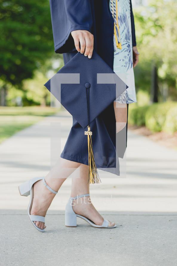 female graduate in heels