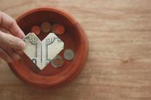 fifty dollar bill folded into the shape of a heart