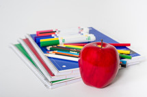 School supplies with an apple.