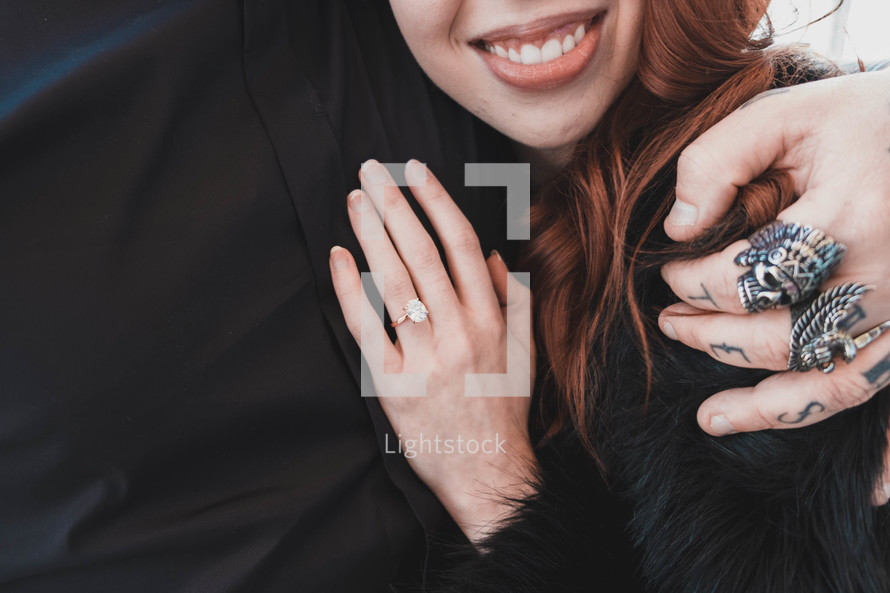 hands of an engaged couple