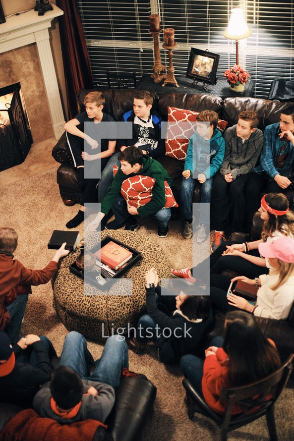 youth at a Bible study sitting on couches in a living room