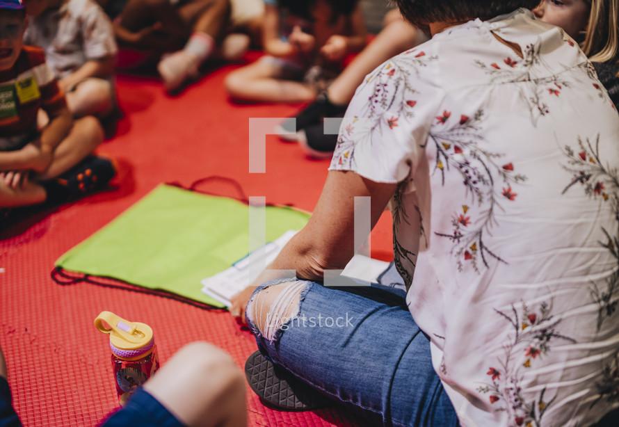 children learning sitting on the floor