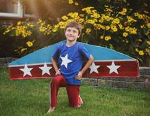 a little boy dressed like an airplane
