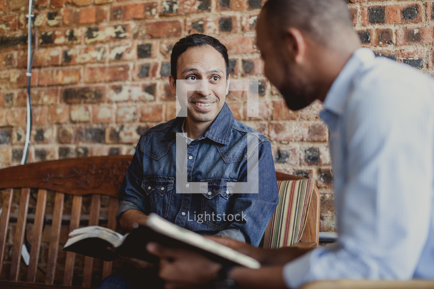 men reading Bibles at a Bible study