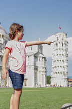 girl pointing near the Leaning Tower of Pisa
