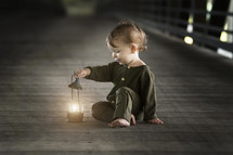toddler boy with a lantern