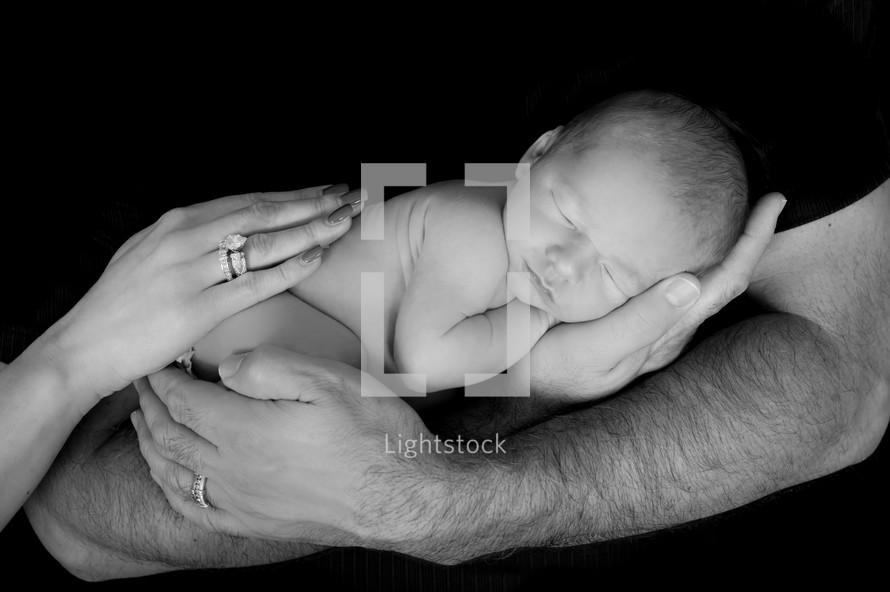 hands holding a newborn baby