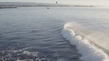 A wave moves along the ocean in slow motion.