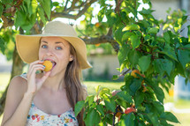 a woman eating an apricot