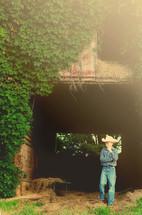 Boy in barnyard