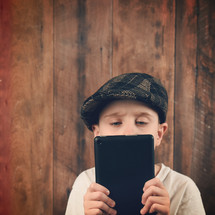 a child holding an tablet