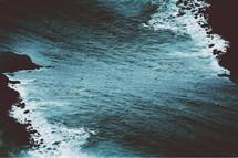 Ocean waves crashing on the rocks.