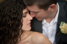bride and groom nose to nose