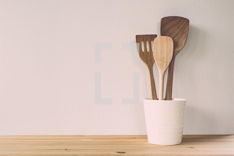 wooden utensils in a jar