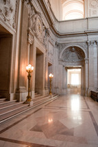 marble floor and decorative stone walls in a grand building