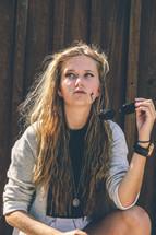 teen girl holding sunglasses