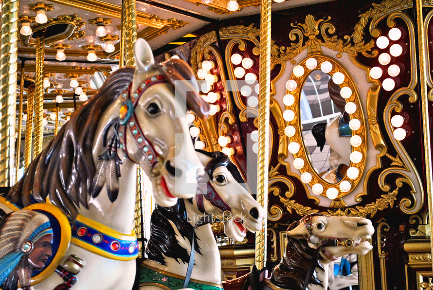 Carousel ponies racing endlessly to nowhere.
