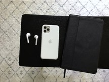 iPhone, AirPods, and journal