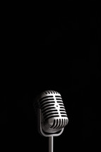 microphone against a black background.