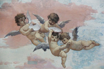 Cherubs against clouds painted on a church ceiling