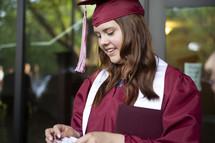teen on graduation day